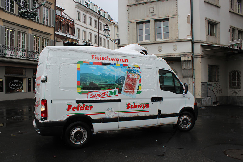 Switzerland, Lucerne, Food Delivery Van Covered in Snow