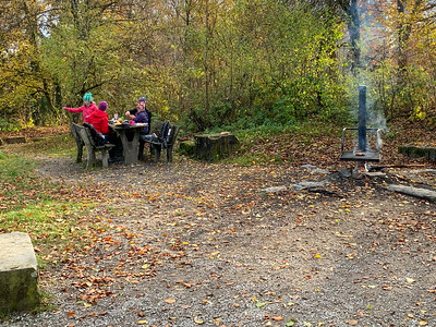 A family enjoys a cookout picnic along the Uetliberg-Felsenegg pathway, Zurich.