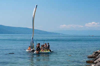 Two paddleboards with young children explore Le Fork sculpture on the Vevay lakeshore.