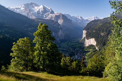 Morning view of Mönch, Jungfrau, Breithorn peaks. and Wengen and Lauterbrunnen villages, from Mönchblick viewpoint, Wengwald.