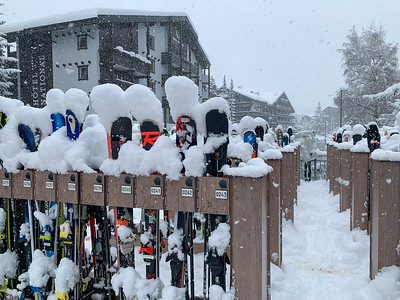 Skis waiting out a snowstorm in Zermatt, Switzerland.