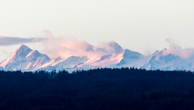 Finsteraarhorn, Lauteraarhorn, Schreckhorn, and Wetterhorn, as seen from Zürichberg at sunrise.