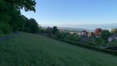 View of the Alps, Zürichsee, and Zürich, from Zürichberg viewpoint.