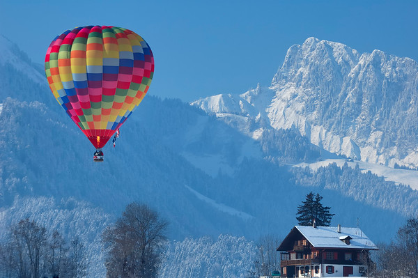 Balloon in the Swiss Alps, with chalet