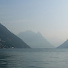 The layered view of Italian Alps, perhaps, across Lake Lugano from Switzerland.