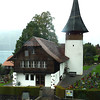 Every little town, it seems, has a wonderful little church and its churchyard. This is seen from the train that skirts Lake Thun.