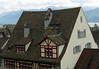 Yes this house's roofline is saggy, but probably on purpose.  I love the chimneys.  Rapperswil.