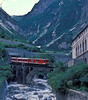 Furka Oberalp Deh4/4 'Disentis/Muster' drops down into Goschenen with the 17:54 train from Andermatt on 3 July 1988