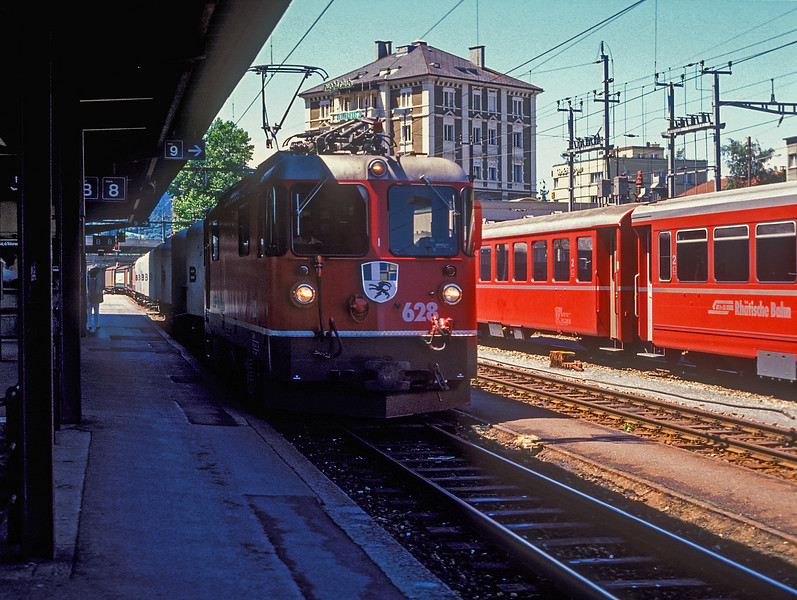 RhB Ge4/4ii 628 'S-Chanf' runs through Chur with a long freight service on 6 July 1988