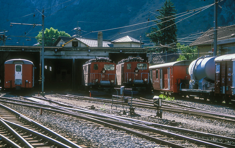 Furka Oberalp HGe4/4 32 and 37 sit outside the old depot at Brig on 6 July 1988