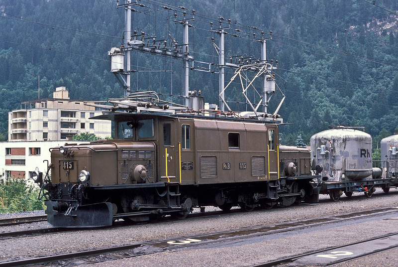 RhB 'Baby Krokodil' Ge6/6 415 pulls into Thusis on 4 July 1988 with the morning mixed train, the visible freight cars being the typical RhB cement tankers