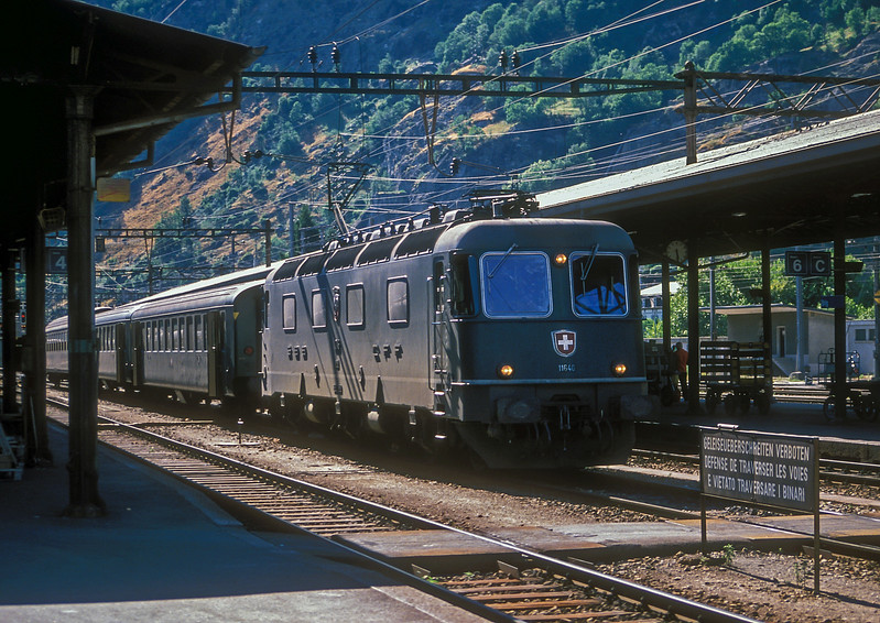 SBB Re6/6 11646 'Bussigny' sits in the station at Brig with a short train of elderly coaches on 6 July 1988