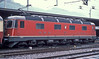Few Re 6/6 locos were painted in red livery - 11615 'Kloten' has taken over duties on EC4 Sestri to Dortmund on 3 July 1988 at Chiasso