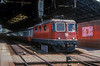 SBB Re4/4ii 11377 has a rake of push/pull 'Airport Express' stock in tow at Lausanne on 9 July 1988