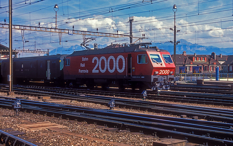 SBB Re4/4iv 10103 departs from Lausanne with train 2028, the 1653 to Geneve Aeroport, on 9 July 1988