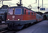 Red Re4/4 II 11390 is at Luzern on 3 July 1988 with train 1792 to Zurich Flughafen