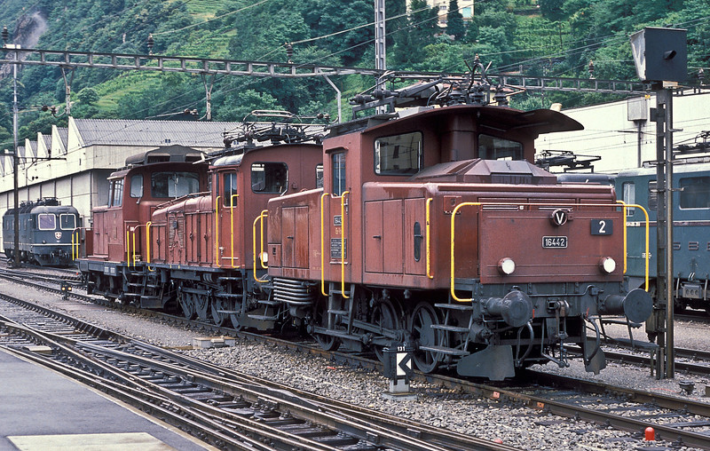 A real mixed bag outside Bellinzona depot on 3 July 1988. Ee 3/3 16442 leads original style Ee 3/3 (built in 1928) 16320 and Em 3/3 18820