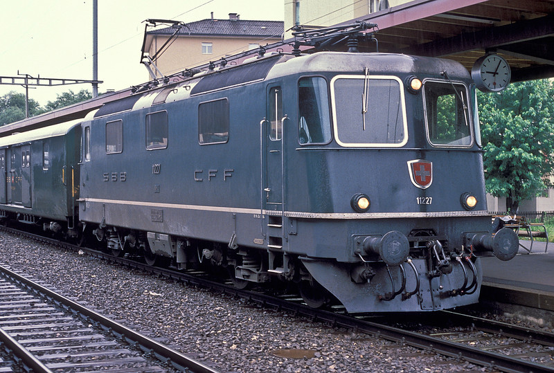 SBB Re4/4 II 11227 is at Sargans on 4 July 1988 with train 8366, the 09:14 to Zeigelbrucke