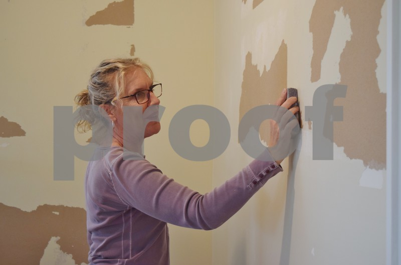 "Fiona Ward of Sycamore prepares a wall for painting at the Sycamore History Museum, 1730 N. Main St. in Sycamore. The museum's new exhibit, ""Adventures To and From Sycamore,"" will have a grand opening from 1 to 3 p.m. Saturday, April 22."