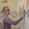 """Fiona Ward of Sycamore prepares a wall for painting at the Sycamore History Museum, 1730 N. Main St. in Sycamore. The museum's new exhibit, """"Adventures To and From Sycamore,"""" will have a grand opening from 1 to 3 p.m. Saturday, April 22."""