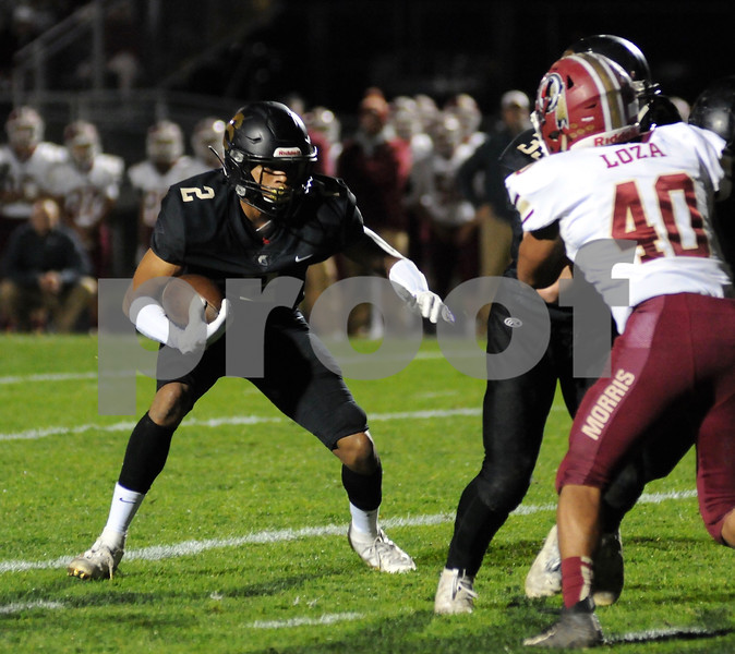 Spartan running back De'Shaun Harris follows a block during first half action against Morris on Friday.  Steve Bittinger - For Shaw Media