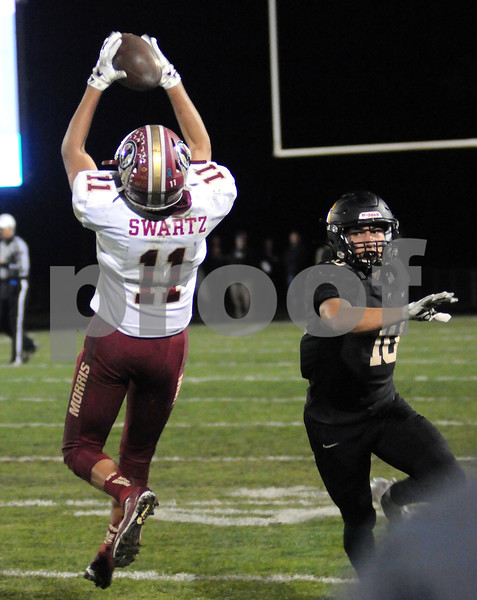 Morris wide receiver Nolan Swartz grabs a pass in second half play at Sycamore on Friday night.  Steve Bittinger - For Shaw Media