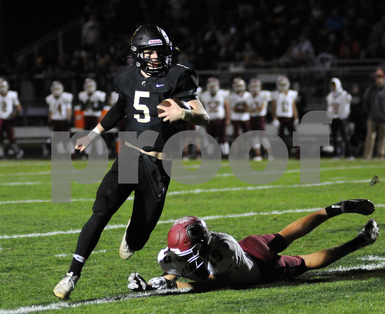 Spartan quarterback Grant McConkey carries the ball against Morris on Friday in Sycamore.  Steve Bittinger - For Shaw Media