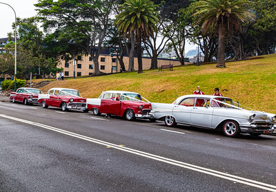Row of vintage wedding cars.