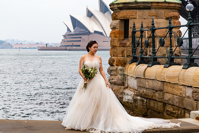 Editorial photo of wedding shoot with Sydney Opera House as backdrop. Sydney Opera House is famous for wedding photo shoot.