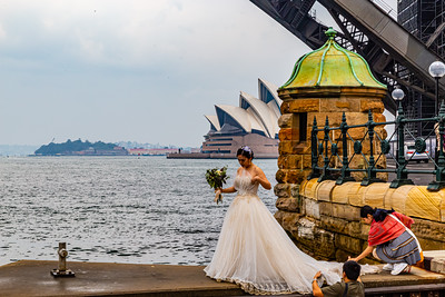 Editorial photo . Wedding party photography common in Sydney Harbor with the backdrop of Sydney Opera House and Sydney Harbor Bridge. Sydney New South Wales Australia.  Australia.