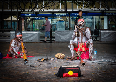 Indigenous people or aboriginal music performers at Circular Quay, Sydney Harbor, Sydney New South Wales Australia.