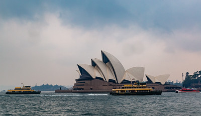 Sydney Opera House Sydney New South Wales Australia.  Ships and boats cruising the harbor  Editorial photo.