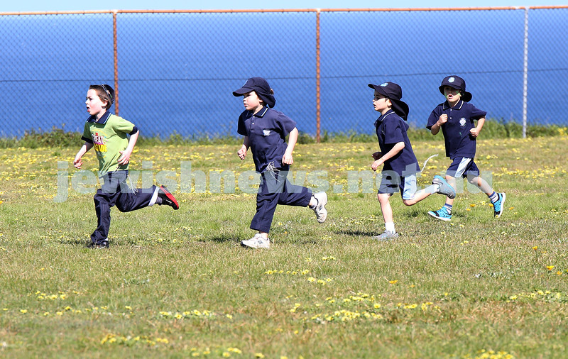 Kesser Torah College Infants Primary Sports Carnival. Year one 400m. Mendel Moss leads the pack.