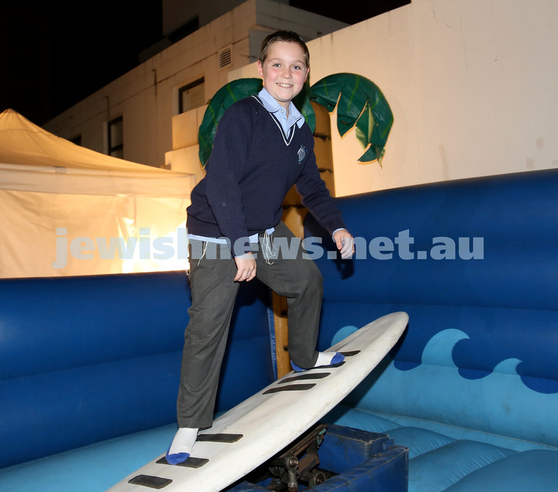 Combined shules Lag Ba'Omer celebration at Tzemach Tzedek Shule. Chaim Groner surfing.