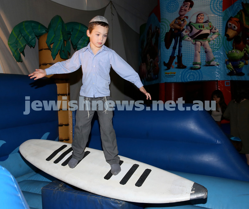 Combined shules Lag Ba'Omer celebration at Tzemach Tzedek Shule. Tzvi Bloom surfing.