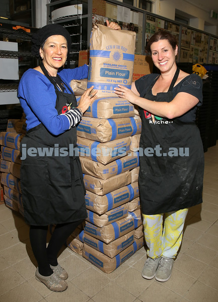 Bonita Levy & Bianca Maserow at OBK next to bags of flour for the Big Challah Bake on Thursday as part of The Shabbat Project.