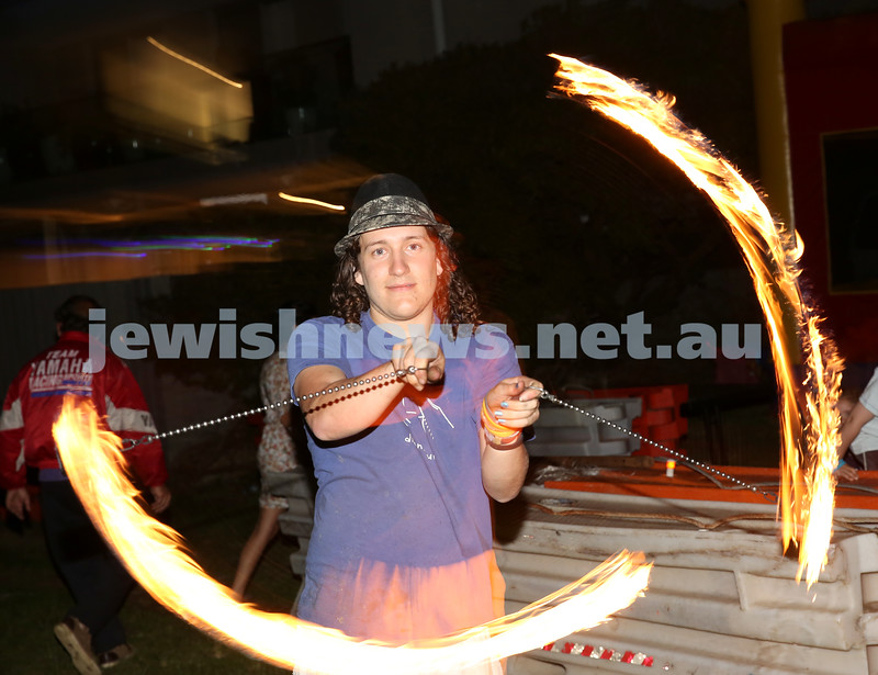 Pizza In The Hut Succot Party at Barracluff Park in Bondi. Fire juggler Eliott Redelman.