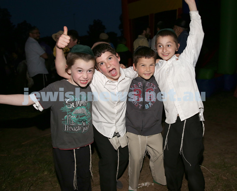 Pizza In The Hut Succot Party at Barracluff Park in Bondi. Mendel Moss, Shaya Sufrin, Bentzion Sufrin, Yisroel Moss dance together.