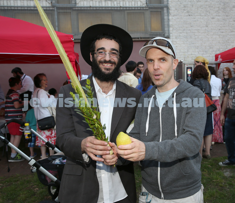 Pizza In The Hut Succot Party at Barracluff Park in Bondi. Benny Barukh shows Darren Zelazne how to shake the Lulav and Etrog.