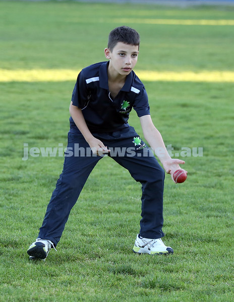 Maccabi Junior Cricket training at Rose Bay. Ethan Corrick releases the ball during fielding practice.