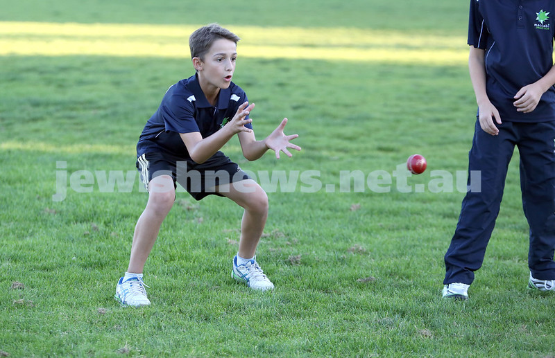 Maccabi Junior Cricket training at Rose Bay. Sam Wein about to catch the ball during fielding practice.