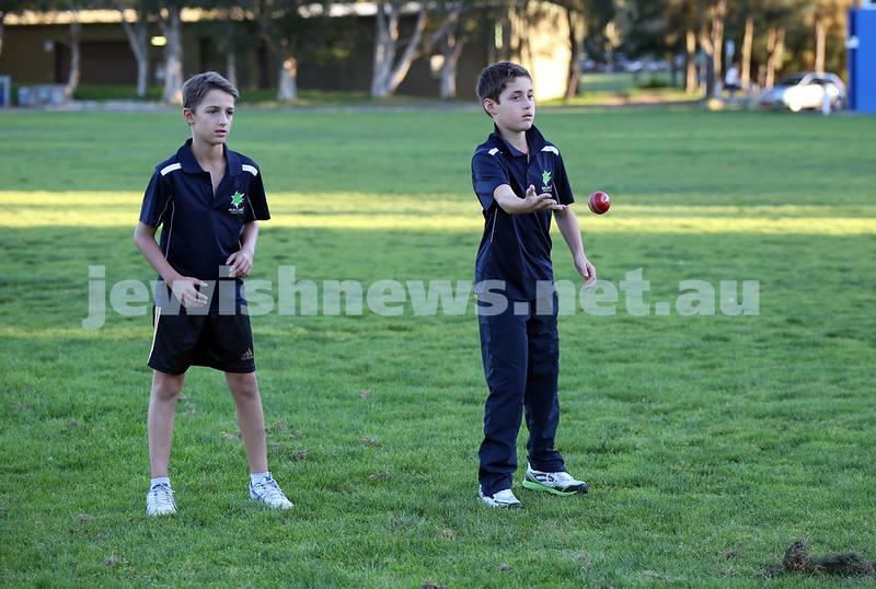 Maccabi Junior Cricket training at Rose Bay. Sam Wein (L) and Ethan De Melo (R) during fielding practice.