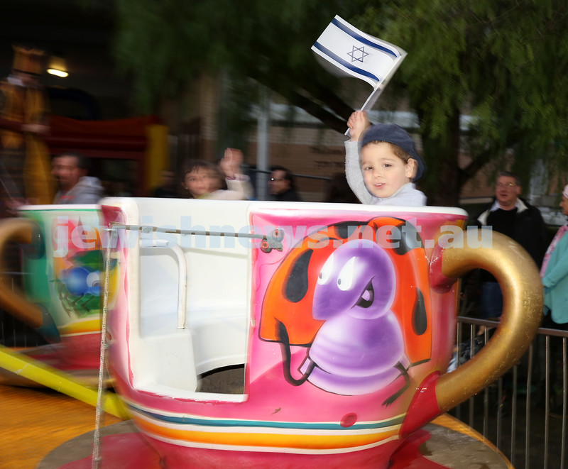 Communal Yom Haatzmaut Celebration at Moriah College. Zac Garson on the Tea Cup ride.