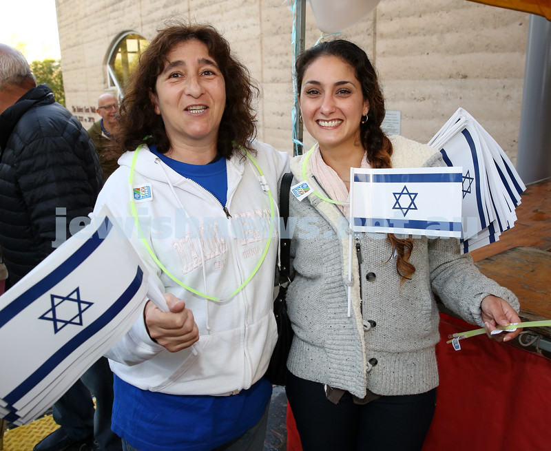 Communal Yom Haatzmaut Celebration at Moriah College. Michal Deckel & Tal Karni handing out Israeli flags.