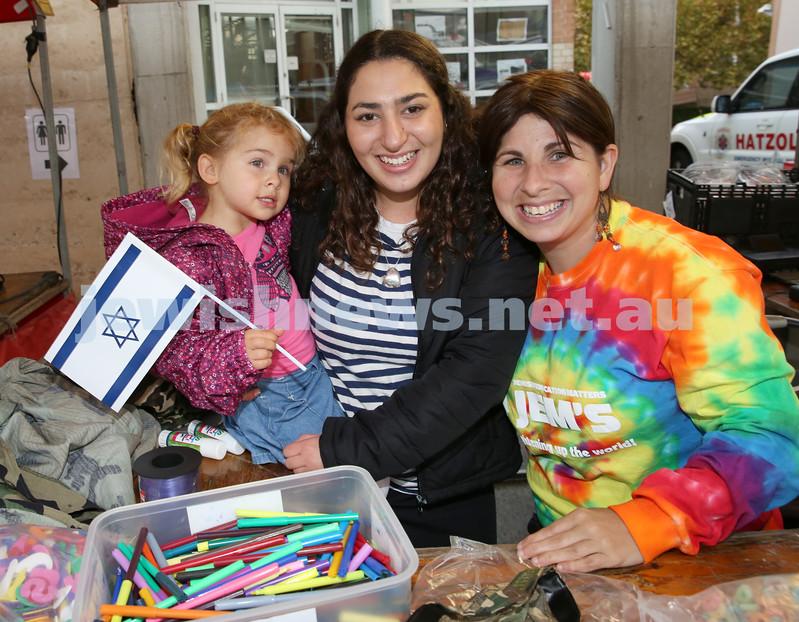 Communal Yom Haatzmaut Celebration at Moriah College. Chavi Lazarus holding Shaina Bracha Shuchat & Rivky Shuchat.