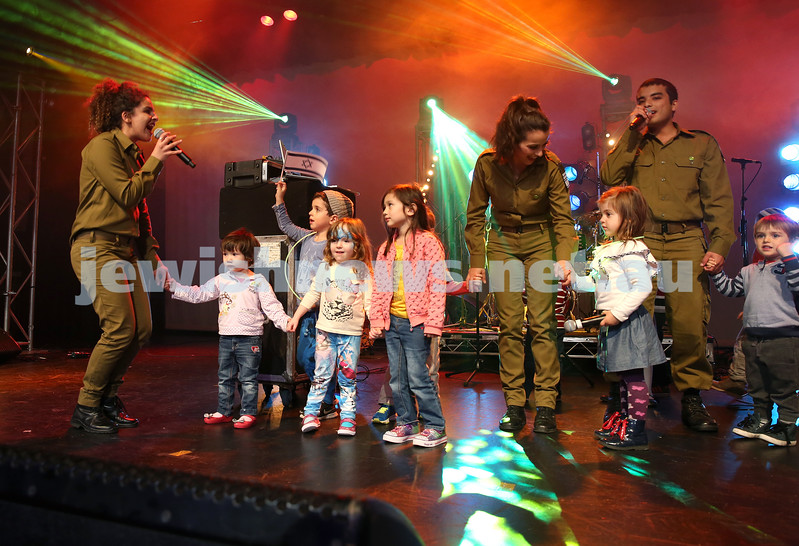 Communal Yom Haatzmaut Celebration at Moriah College. IDF Band perform on stage with a group of young children who took to the stage.