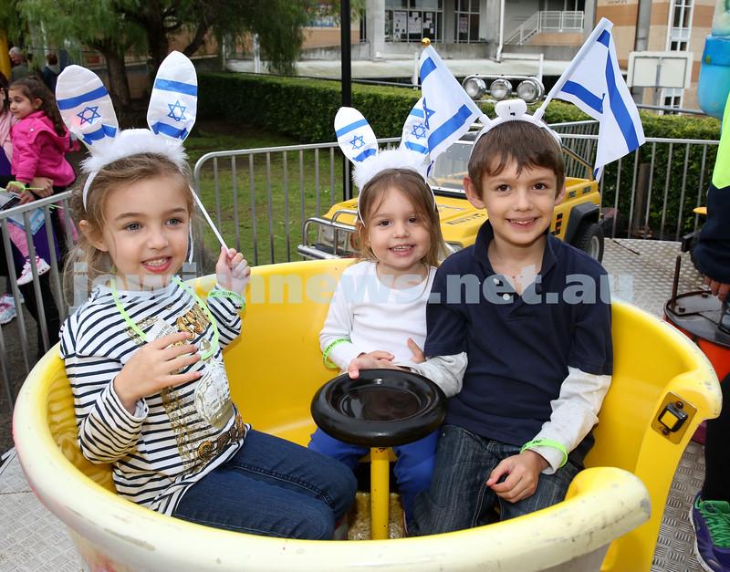 Communal Yom Haatzmaut Celebration at Moriah College. Lara, Ruby, Jake Isenberg on the Tea Cup ride.