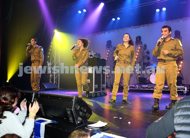 Communal Yom Haatzmaut Celebration at Moriah College. IDF Band perform on stage.