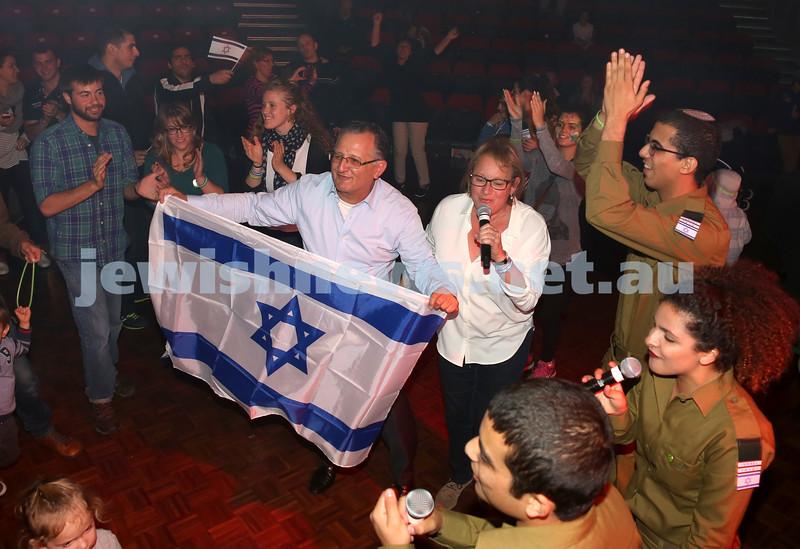 Communal Yom Haatzmaut Celebration at Moriah College. Richard Balkin dancinf with the Israeli Flag.
