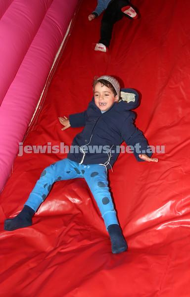 Communal Yom Haatzmaut Celebration at Moriah College. Neriah Harkham on the giant inflatable slide.